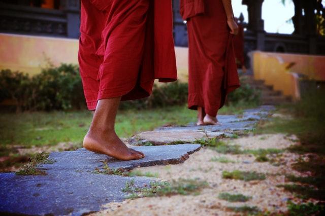 two-human-wearing-monk-dress-walking-on-the-pathway-776291.jpg